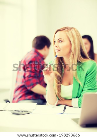 education concept - student girl with notebook and calculator in college - stock photo