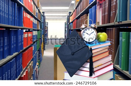 Education concept with stack of book in the library - stock photo