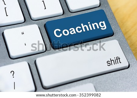 Education concept: Written word Coaching on blue keyboard button.