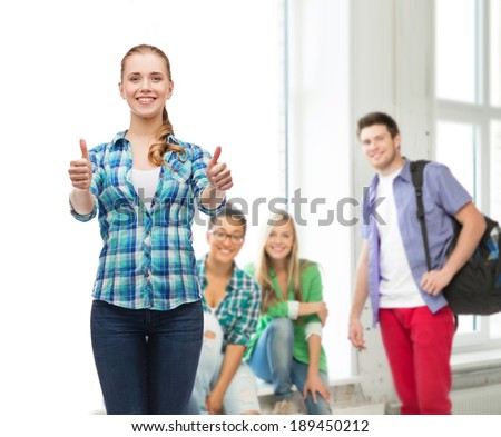 education concept - young woman in casual clothes showing thumbs up
