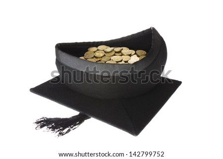 Education Costs - Mortar Board Graduation Cap Full of Coins - stock photo