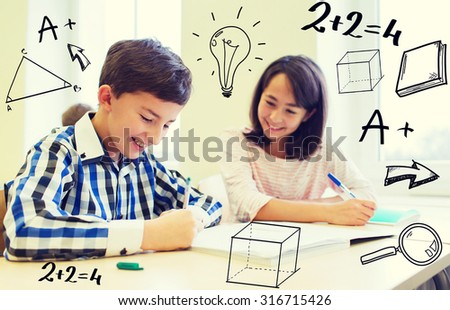 education, elementary school, learning and people concept - group of school kids with pens and notebooks writing test in classroom with doodles - stock photo