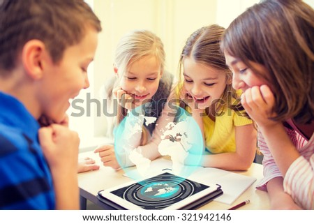 education, elementary school, learning, technology and people concept - group of school kids looking to tablet pc computer screen with globe hologram on break in classroom - stock photo