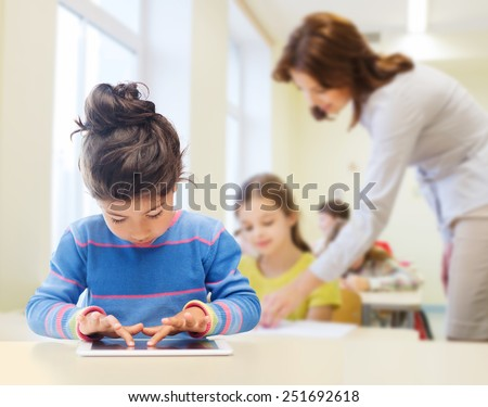 education, elementary school, technology and children concept - little student girl with tablet pc over classroom and teacher background