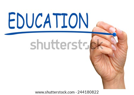 Education - female hand writing text with blue pen - stock photo