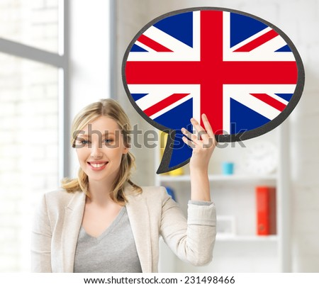 education, fogeign language, english, people and communication concept - smiling woman holding text bubble of british flag - stock photo