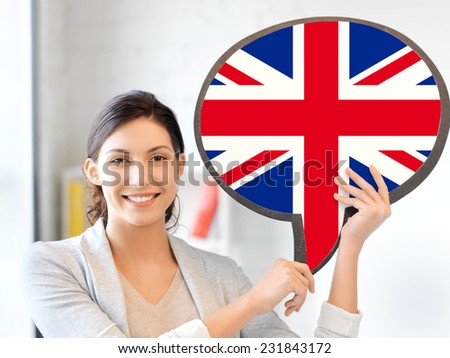 education, foreign language, english, people and communication concept - smiling woman holding text bubble of british flag - stock photo