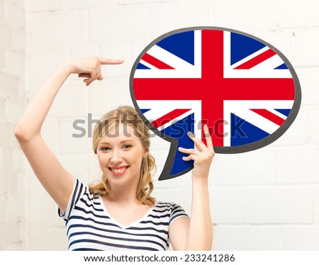 education, foreign language, english, people and communication concept - smiling woman holding text bubble of british flag and pointing finger - stock photo