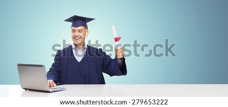 education, graduation, business, technology and people concept - happy adult student in mortarboard with diploma and laptop computer sitting at table over blue background - stock photo