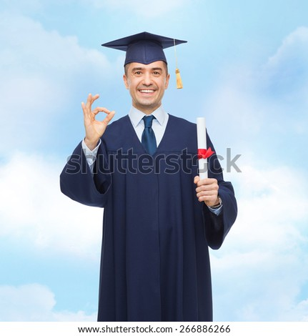 education, graduation, gesture and people concept - smiling adult student in mortarboard with diploma showing ok hand sign over blue sky background - stock photo