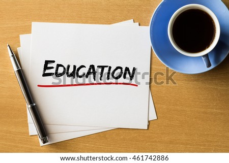 Education - handwriting on papers with cup of coffee and pen, business concept