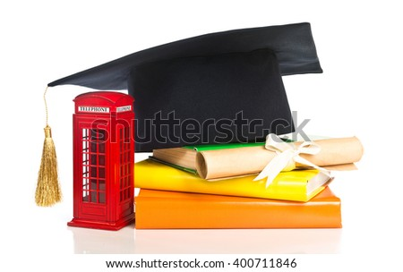 education in Great Britain Concept. Stack of books, mortarboard, diploma and red phone box - symbol of England - stock photo