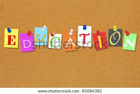 EDUCATION, letters pinned on a cork bulletin board