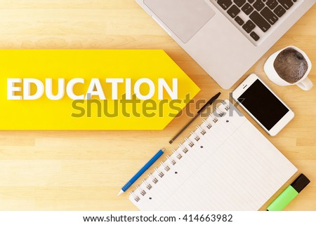 Education - linear text arrow concept with notebook, smartphone, pens and coffee mug on desktop. - stock photo