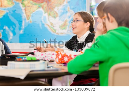 Education - Pupils at primary or elementary school doing their homework or having a school test - stock photo