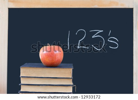 education: 123's on chalkboard with apple & old books - stock photo