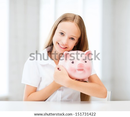 education, school and money saving concept - child with piggy bank - stock photo
