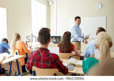 education, school, learning and people concept - group of students and teacher with test results in classroom