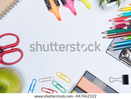 education school supplies on white background ready for your design space. - stock photo