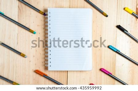 Education stuff on wooden table.pen ,colour pen ,book, Top view - stock photo