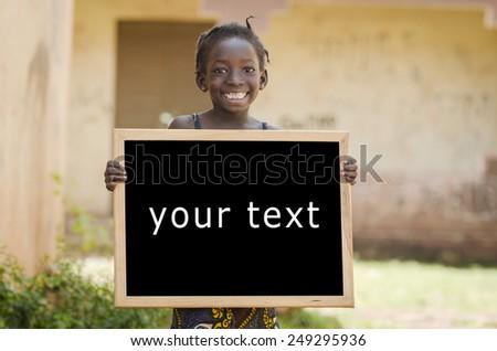 Education Symbol Metaphore: African Ethnicity Girl Holding Blackboard in Mali - stock photo