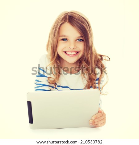 education, technology and internet concept - smiling little student girl with tablet pc computer - stock photo