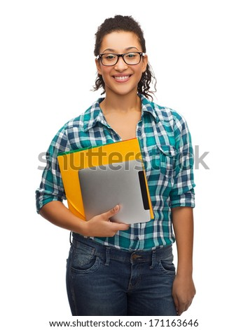 education, technology and people concept - smile female african american student in eyeglasses with folders and tablet pc - stock photo
