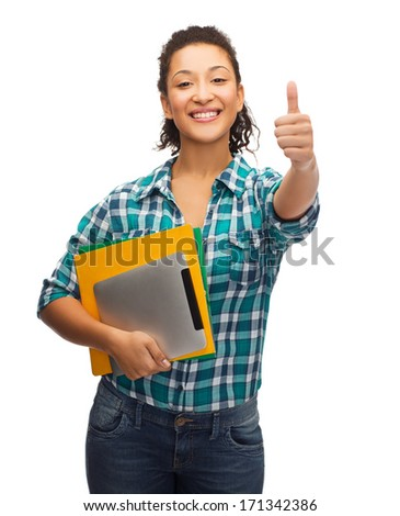 education, technology and people concept - smiling female african american student with folders and tablet pc showing thumbs up - stock photo