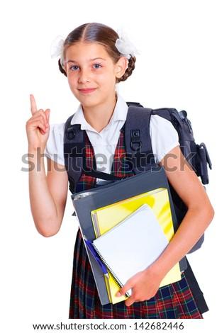 Education theme. Joyful thoughtful schoolgirl with backpack holding book - stock photo