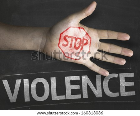 Educational and Creative composition with the message Stop Violence on the blackboard - stock photo