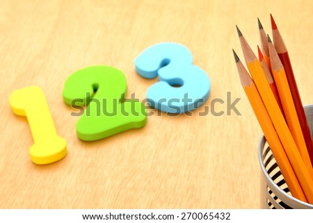 Educational concept, pencils and number toy - stock photo