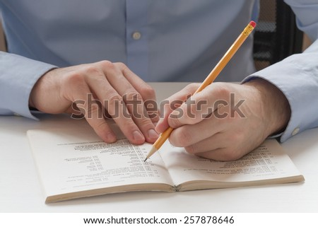 Educational concept. Student mark the correct answer in the test book and preparing for the exam - stock photo
