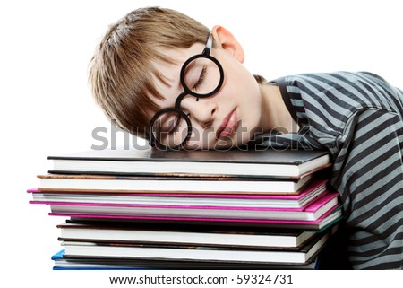 Educational theme: boy teenager sleeping on his books. Isolated over white background. - stock photo