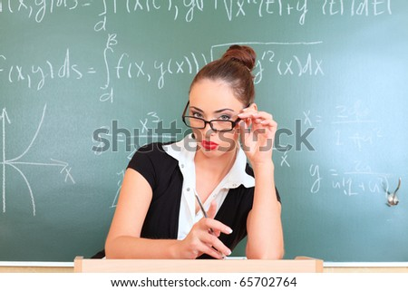 Educational theme: portrait of a teacher giving a lecture. - stock photo
