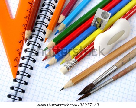 educational tools set on the spiral notepad background