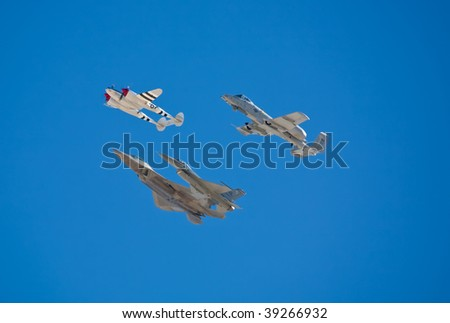 EDWARDS AFB, CA - OCT 17: P-38, A-10, F-16 and F-22 fly in formation at Flight Test Nation 2009, October 17, 2009, Edwards Air Force Base, CA - stock photo