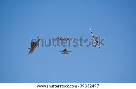 EDWARDS AFB, CA - OCTOBER 17: P-38, A-10, F-16 and F-22 fly in formation at Flight Test Nation 2009, October 17, 2009, Edwards Air Force Base, CA - stock photo