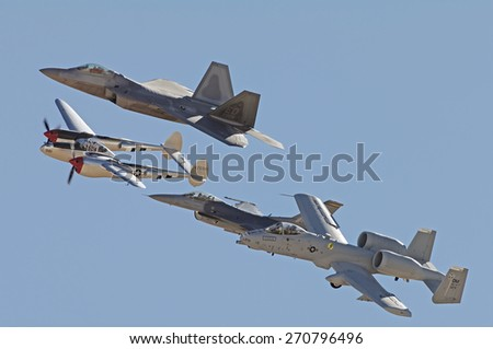 EDWARDS AFB, CA/USA - OCTOBER 17 - F-22A Raptor, P-38J Lightning, F-16, and  OA-10 Thunderbolt Heritage Flyover shown at Flight Test Nation 2009 on October 17, 2009 at Edwards AFB, California, USA. - stock photo