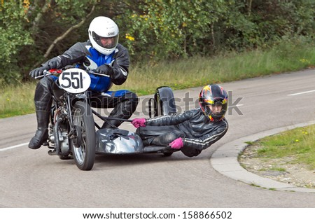 EELMORE, UK - SEPTEMBER 29:  An unnamed sidecar team take a tight left handed bend on their vintage motorcycle rig during the VMCC Ossie Neal memorial sprint on September 29, 2013 in Eelmore