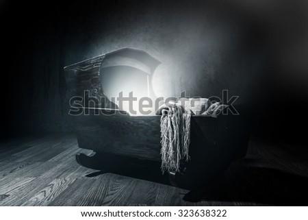 Eerie Cradle. Blue toned  lighting - stock photo