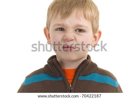Eewww Little boy smells something bad - stock photo