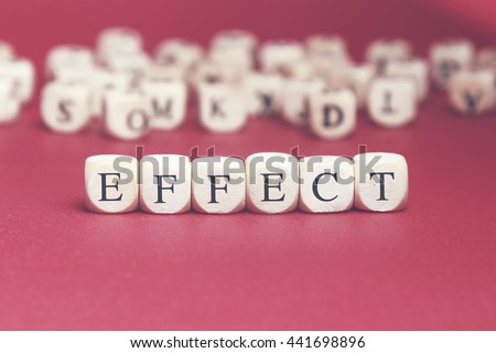 Effect word written on wood cube with red background