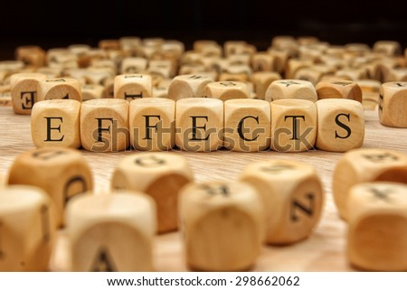 EFFECTS word written on wood block - stock photo