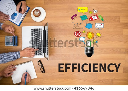 EFFICIENCY Business team hands at work with financial reports and a laptop - stock photo