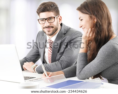 Efficiency financial advisor and business woman analyzing data on laptop, while sitting at office. - stock photo