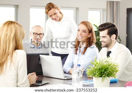 Efficiency sales team with computer sitting at office and working on project. Teamwork at office.  - stock photo