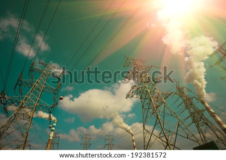 Efficient power transmission tower of sky background - stock photo