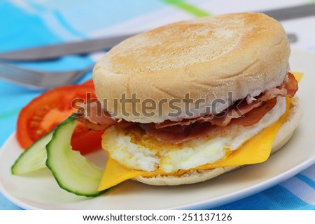 Egg and bacon muffin, closeup  - stock photo