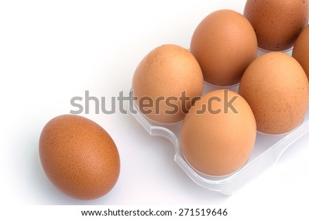 egg and eggs in a package to isolate the background - stock photo