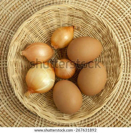 Egg and onion in rattan basket